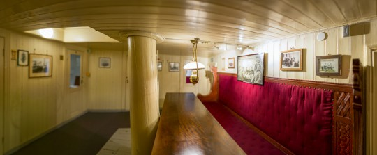 The Nansen Saloon is surrounded by smaller cabins. The Saloon is open to the public and can even be hired for private events.